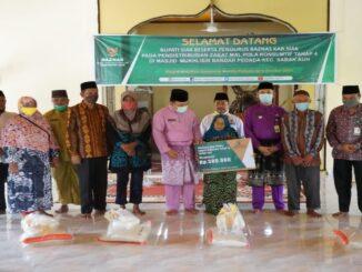 Teks : Wakil Bupati Siak Husni Merza mengajak seluruh masyarakat untuk membayar zakat (foto/istimewa)